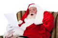Santa Claus reading wish list Royalty Free Stock Photo
