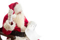 Santa Claus receives a wish list Royalty Free Stock Photo