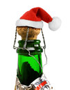 Santa claus red hat in champagne bottle isolated on white background Royalty Free Stock Photography