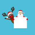 Santa Claus and reindeer with a blank Royalty Free Stock Photo
