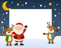 Santa claus and reindeer frame christmas horizontal photo with a happy cartoon character two cute on the snow eps file available Stock Photo