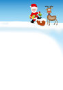 Santa Claus with a reindeer on the roof Royalty Free Stock Photo