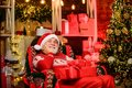 Santa Claus relaxing in arm chair. Bearded senior man Santa Claus. Traditions concept. Elderly grandpa at home. Legend Royalty Free Stock Photo