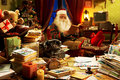 Santa claus relaxing at home the messy desk of he reading a book Royalty Free Stock Images