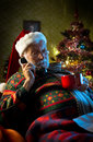 Santa Claus relaxing at home on the phone Royalty Free Stock Photo