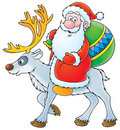 Santa Claus riding on the reindeer Stock Images