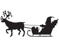 Santa claus riding a sleigh with reindeer silhouette image of Royalty Free Stock Photography
