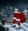 Santa Claus on roof with bag full of gifts on Christmas eve
