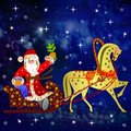 Santa claus with the sack of gifts in sledges in a team with a h horse on background star sky Stock Photo