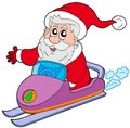 Santa Claus on scooter Royalty Free Stock Photos