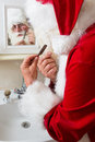 Santa claus is shaving Royalty Free Stock Photo
