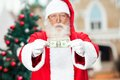 Santa claus showing one dollar note Imagens de Stock