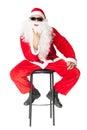 Santa Claus showing the rocker hand sign and smoking a cigar Royalty Free Stock Photo