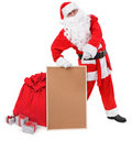 Santa claus shows empty bulletin board Royalty Free Stock Image