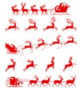Santa Claus silhouette riding a sleigh with deers.