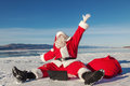 Santa Claus sitting on snow glad news in the laptop Royalty Free Stock Photo