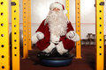 Santa claus sitting in yoga position in gym meditation Royalty Free Stock Image