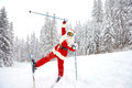 Santa Claus skiing in the mountains on snow in winter in Christm Royalty Free Stock Photo