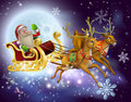 Santa claus sleigh christmas scene a of flying through the air on his sled being pulled by reindeer with snowflakes Stock Images