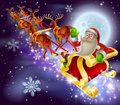Santa claus sleigh christmas scene a of flying through the air on his sled being pulled by reindeer with snowflakes Stock Image