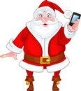 Santa Claus with a smart phone Stock Photos