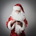 Santa Claus and smart phone Royalty Free Stock Photo