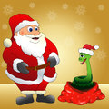 Santa Claus and the snake Stock Image