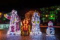 Santa Claus and Snow White statues brightly lit Royalty Free Stock Photo