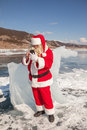 Santa claus standing outdoors at ice that calls to whom by phone Stock Images