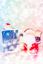 Santa Claus standing in the snow fake with a blackboard Royalty Free Stock Photo