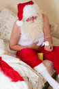 Santa claus with stomach ache poor elderly suffering from taking medicine Stock Photography