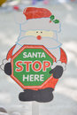 Santa claus stop here christmas paper sign Royalty Free Stock Photo