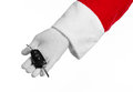 Santa claus theme santa s hand holding the keys to a new car on a white background studio Stock Image
