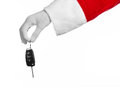 Santa claus theme santa s hand holding the keys to a new car on a white background studio Royalty Free Stock Image