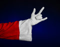 Santa claus theme santa s hand showing gesture on a dark blue background studio Stock Photography