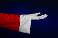 Santa claus theme santa s hand showing gesture on a dark blue background studio Stock Images