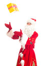Santa claus throws gift isolated on white Royalty Free Stock Photography