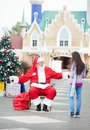 Santa claus about to embrace girl full length of in courtyard Stock Photo