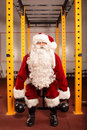Santa claus training before christmas in gym kettlebells Royalty Free Stock Photos
