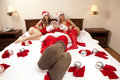 Santa Claus with two sexy girls Royalty Free Stock Photos