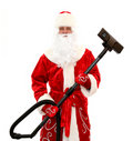 Santa Claus with a vacuum cleaner Stock Photos