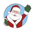 Santa Claus Waving Through a Circle Royalty Free Stock Photos