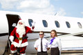 Santa claus waving good bye from steps of jet Royalty Free Stock Image