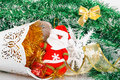 Santa Claus with white bucket, red gift box and white snowflake Royalty Free Stock Photo
