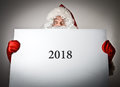Santa Claus and white paper. Two thousand and eighteen concept. Royalty Free Stock Photo