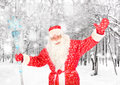 Santa claus in winter forest happy with christmas staff the Royalty Free Stock Photo