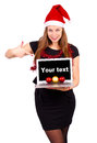Santa claus woman holding a laptop attractive with hat computer Stock Photography
