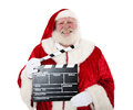 Santa clause with clapperboard in front of white background Stock Photography