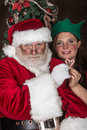 Santa clause and a little elf his came for visit she is just so cute now back to making toys for the girls boys for christmas Stock Photography