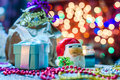 Santa Clause,presents,candles and Christmas ornaments Royalty Free Stock Photo